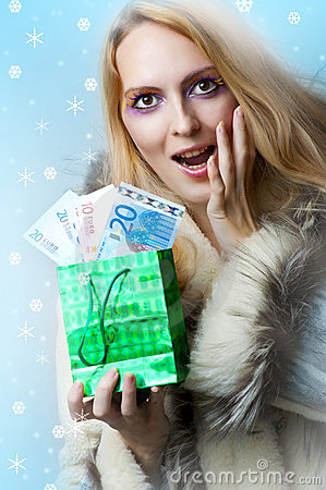 Beautiful woman winner holding money