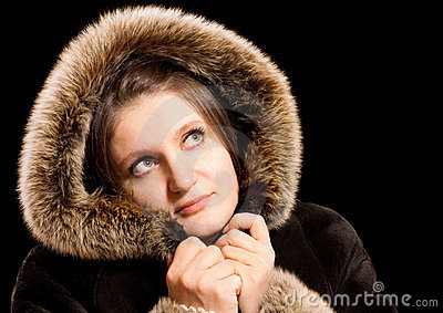 Beautiful woman in winter fur coat