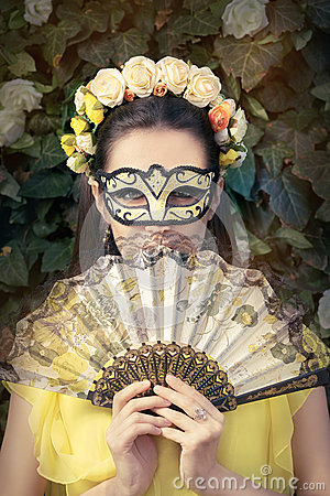 Free Beautiful Woman With Floral Wreath, Mask And Fan Stock Image - 56922101