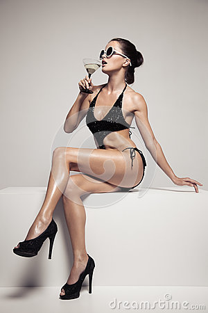 Free Beautiful Woman With Glamour Make Up In Stylish Black Swimwear. Drink Glass Cocktail. Royalty Free Stock Photo - 89586385