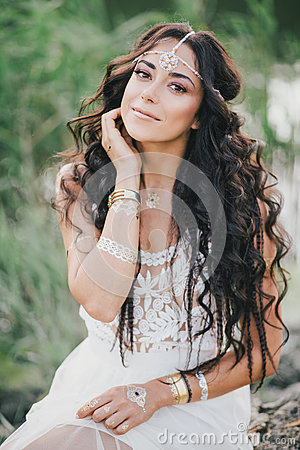 Free Beautiful Woman With Long Curly Hair Dressed In Boho Style Dress Posing Near Lake Stock Photos - 58376663