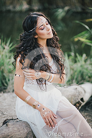 Free Beautiful Woman With Long Curly Hair Dressed In Boho Style Dress Posing Near Lake Stock Photography - 58696092