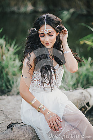 Free Beautiful Woman With Long Curly Hair Dressed In Boho Style Dress Posing Near Lake Stock Photo - 58696160