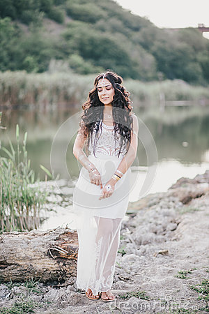 Free Beautiful Woman With Long Curly Hair Dressed In Boho Style Dress Posing Near Lake Royalty Free Stock Photography - 58696457