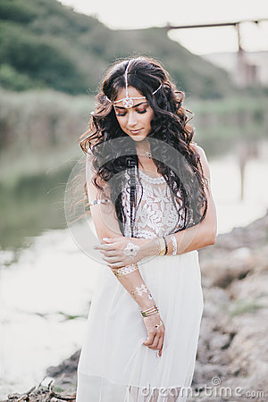Free Beautiful Woman With Long Curly Hair Dressed In Boho Style Dress Posing Near Lake Stock Image - 58696531