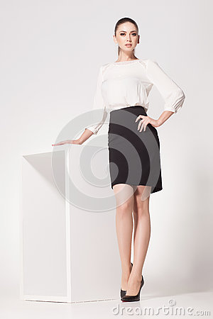 Free Beautiful Woman With Long Sexy Legs Dressed Elegant Posing In The Studio Royalty Free Stock Photo - 42938005
