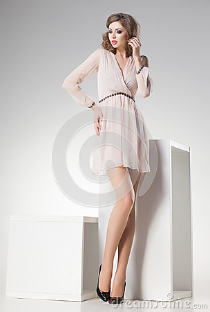 Free Beautiful Woman With Long Sexy Legs Dressed Retro Elegant Posing In The Studio Royalty Free Stock Images - 34876849