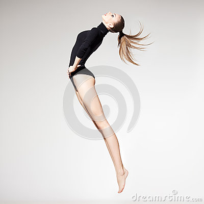 Free Beautiful Woman With Perfect Slim Body And Long Legs Jumping - F Royalty Free Stock Images - 28753429