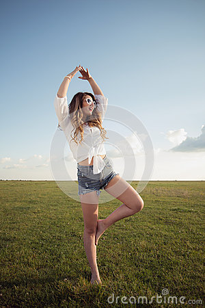 Free Beautiful Woman With Sexy Legs And Denim Shorts On Grass, Shoe Less Stock Image - 41246851