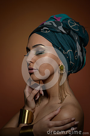 Free Beautiful Woman With Turban. Young Attractive Female With Turban And Golden Accessories. Beauty Fashionable Woman Stock Images - 81108494