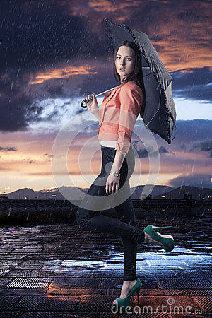 Free Beautiful Woman With Umbrella, Turned In Profile Stock Photos - 26493613