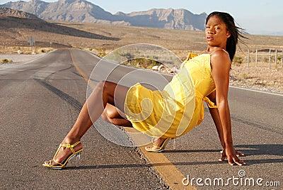 Beautiful woman in yellow dress.