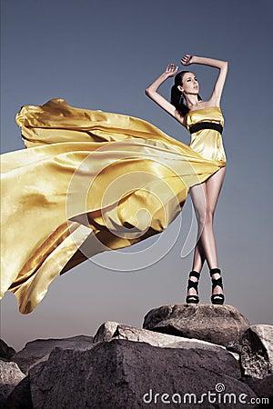 Beautiful woman in yellow evening dress