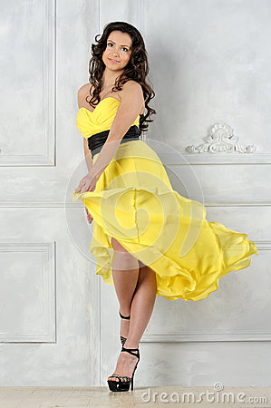 Beautiful woman in yellow evening dress.