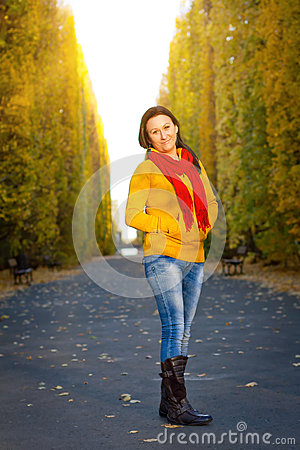 Beautiful woman in the yellow park scenery