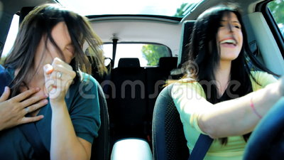 Beautiful women in car dancing while going in vacation. Beautiful women dancing inside car stock video footage