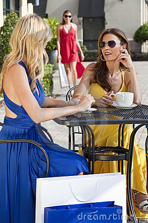 Beautiful Women Having Coffee With Shopping Bags