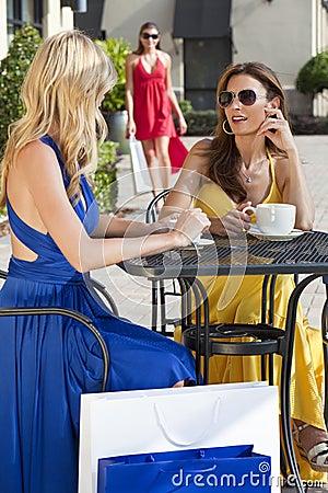 Beautiful Women Having Coffee With Shopping Bags