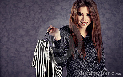 Beautiful women with her shopping bags