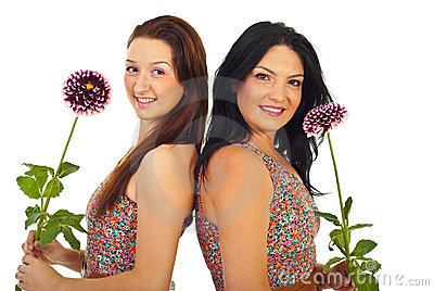 Beautiful women holding flowers
