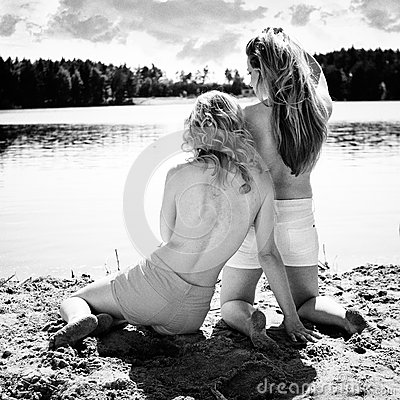 Beautiful women near the lake