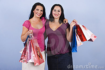 Beautiful women at shopping with bags