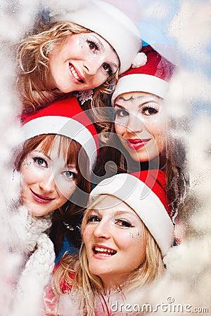 Beautiful women wearing a santa hat