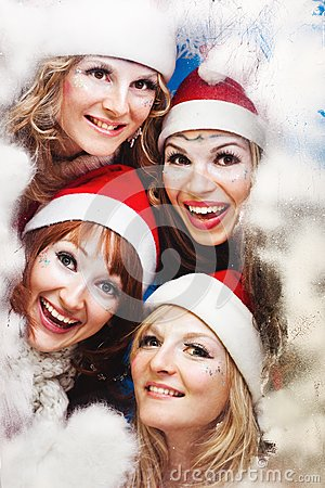 Beautiful women wearing a santa hat