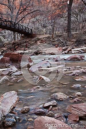Beautiful wooden bridge crossing a river