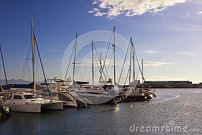Beautiful yachts in harbour at sunrise