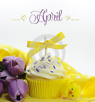 Free Beautiful Yellow Spring Or Easter Theme Cupcake With Seasonal Flowers Tulips And Decorations For The Month Of April Stock Photo - 40685210