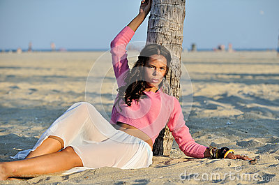Beautiful youn biracial woman on beach
