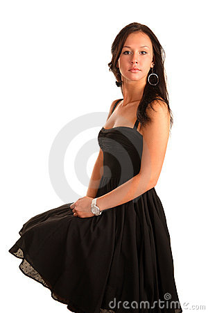 Beautiful young adult girl sits in black dress