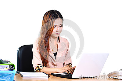 Beautiful young asian businesswomen smiling with computer notebo