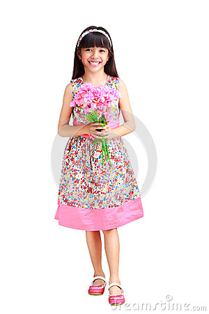 Beautiful young asian girl in a dress with a flower in her hand