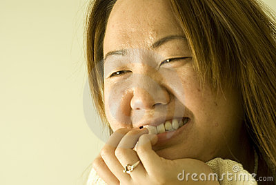 Beautiful young Asian woman, smiling, laughing
