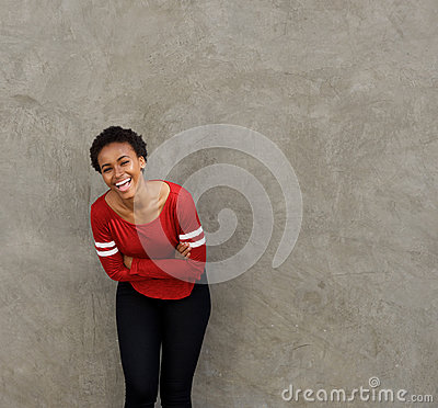 Free Beautiful Young Black Woman Leaning Against Wall And Laughing Royalty Free Stock Photos - 92170078