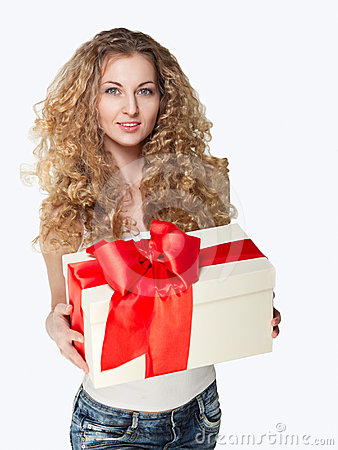 Beautiful young blond girl holding present