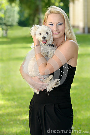 Beautiful young blond woman posing with her dog