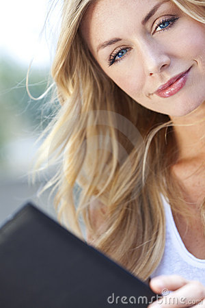 Beautiful Young Blond Woman Reading Folder or Menu