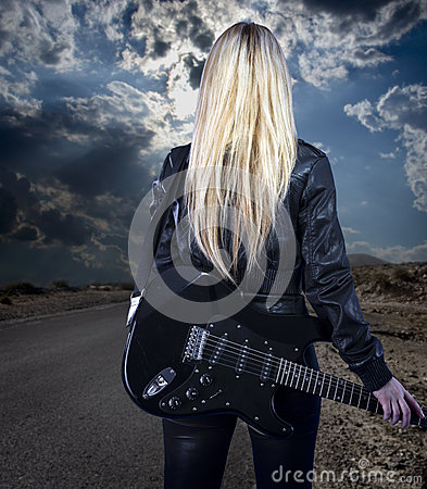 Free Beautiful Young Blonde Dressed In Black Leather With Electric Gu Royalty Free Stock Photography - 30190277