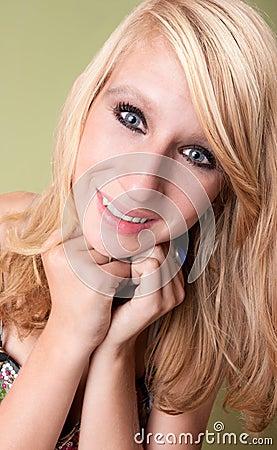 Beautiful young blonde teen girl in studio