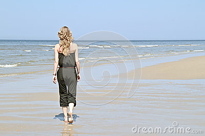 Beautiful young blonde woman at the beach