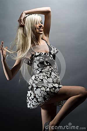 Beautiful young blonde woman on a grey background
