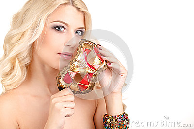 Beautiful young blonde woman in a mysterious Venetian mask.