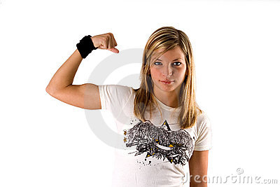 Beautiful young blonde woman in a tee shirt making a muscle
