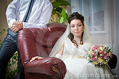 Beautiful young bride and groom indoor setting