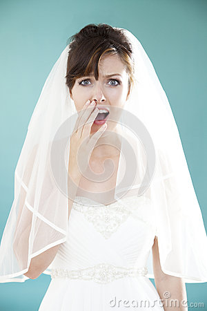 Beautiful young bride looking shocked