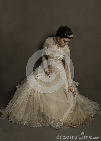 Free Beautiful Young  Bride Settling Her Vintage Wedding Dress Stock Photography - 62668632