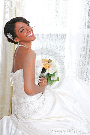 Beautiful Young Bride Sitting by Window